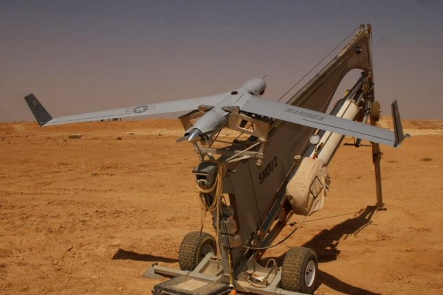 A ScanEagle unmanned aircraft is pictured mounted on it's launch catapult. Photo courtesy of the U.S. Marine Corps.