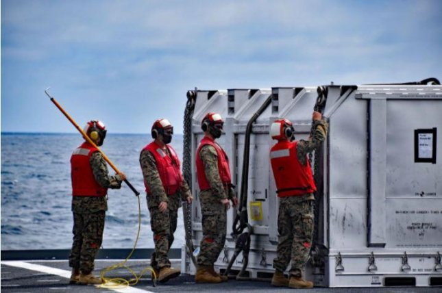 Personnel aboard the USNS Richard E. Byrd assist with helicopter operations during the first at-sea transfer of an F135 engine power module load simulator. Photo by Sarah Burfeld/Military Sealift Command Pacific