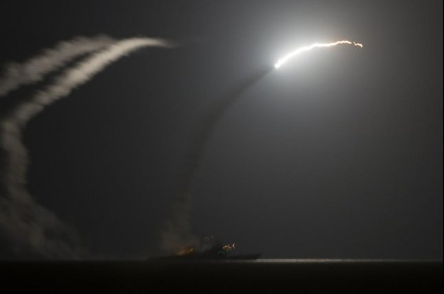 The guided-missile cruiser USS Philippine Sea launches a Tomahawk cruise missile to conduct strikes against ISIS targets, as seen from the aircraft carrier USS George H.W. Bush in September 2014. Photo courtesy U.S. Department of Defense