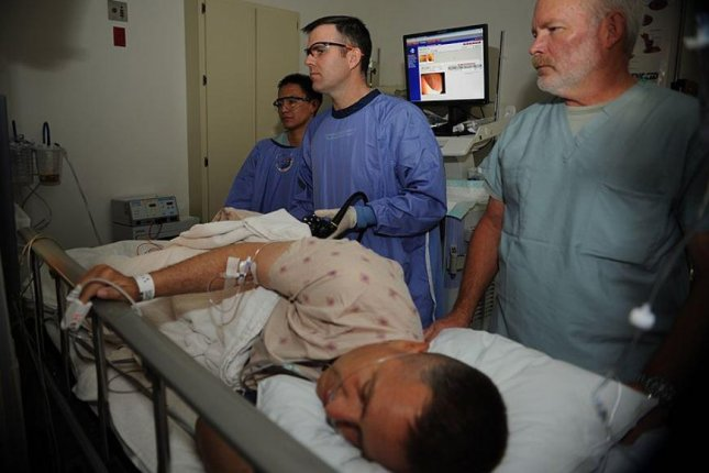 Registered Nurse Steven Cherry reviews the monitor while Lt. Cmdr. Eric A. Lavery uses a colonoscope on a patient during a colonoscopy at Naval Medical Center San Diego in 2011. Photo by Mass Communication Specialist 2nd Class Chad A. Bascom/U.S. Navy