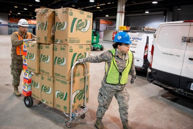 Members of the Illinois Air National Guard assemble medical equipment at the McCormick Place Convention Center in response to the COVID-19 pandemic in Chicago in April. Photo by Jay Grabiec/U.S. National Guard