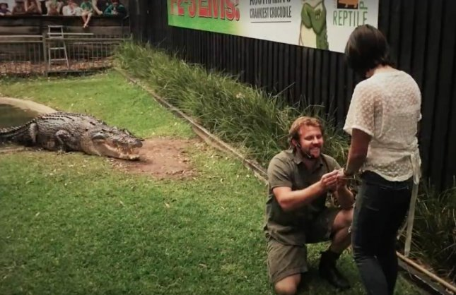 Australian reptile handler Billy Collett proposed to his girlfriend Siobhan Oxley with a 14-foot crocodile named Elvis as their witness. The unique proposal took place inside the crocodile enclosure at Australian Reptile Park where Collett invited Oxley to have a crack at feeding the crocodile before dropping to one knee and presenting her with the ring. 