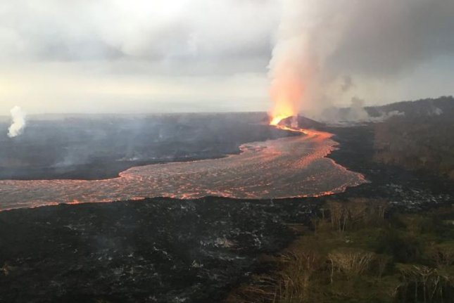 Lava from Kilauea Volcano's Fissure 8 flows Saturday through the well-established channel to the ocean at Kapoho. Photp courtesy USGS
