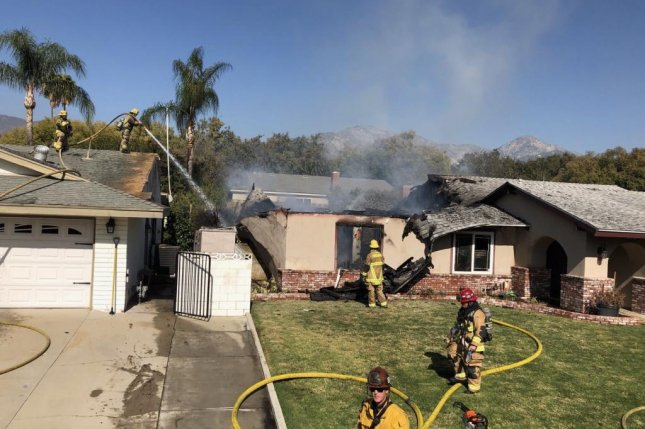 The residents of the home were uninjured after a plane crashed into it and caused a blaze. Photo courtesy of the San Bernardino County Fire Department
