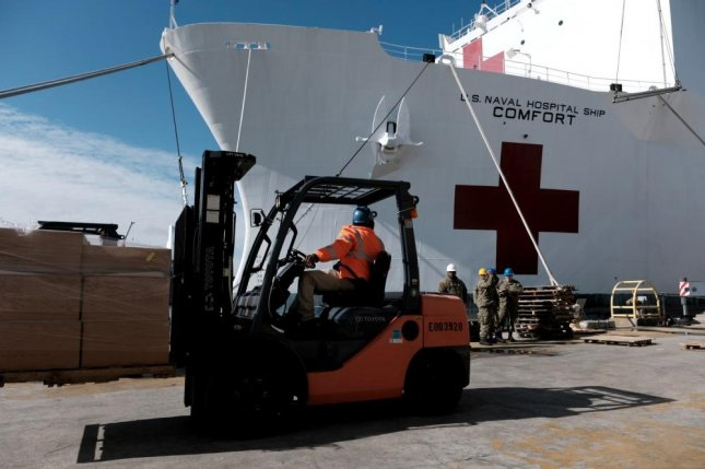 Supplies and personnel are loaded aboard the Military Sealift Command hospital ship USNS Comfort at Naval Station Norfolk, Va., on Tuesday. Photo by Joshua D/ Sheppard/U.S. Navy