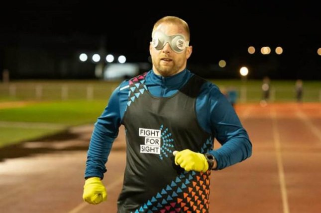 A British man ran a mile in 10 minutes, 11 seconds while wearing a blindfold to set a Guinness World Record. Photo courtesy of Guinness World Records