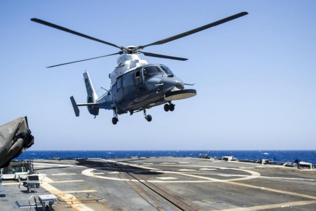 Booz Allen Hamilton has received a $12 million U.S. Navy contract modification to provide support services for the Royal Saudi Navy. A Royal Saudi Navy helicopter is shown landing on the USS Roosevelt during a 2014 exercise. U.S. Navy photo by Mass Communication Specialist 2nd Class Justin Wolpert