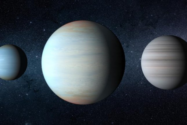 Astronomers found the third planet of the Kepler-47 system, the biggest of the three, orbiting in between the two previously discovered exoplanets. Photo by NASA/JPLCaltech/T. Pyle