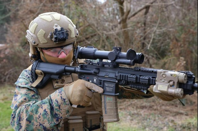 CWO4 Dave Tomlinson, infantry weapons officer at Marine Corps Systems Command, demonstrates the Squad Common Optic attached to the M27 Infantry Automatic Rifle, on Feb. 10 at Marine Corps Base Quantico in Virginia. Photo by Matt Gonzales/U.S. Marine Corps