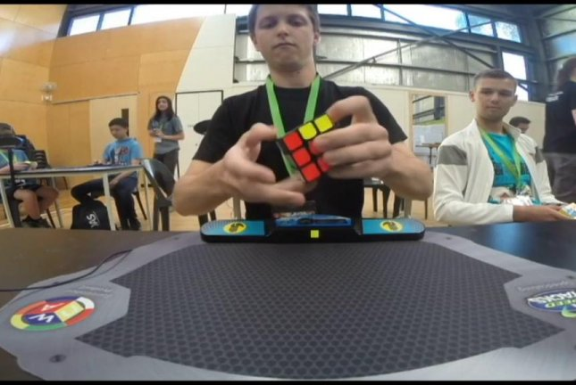 Feliks Zemdegs, 20, breaks the world record for Rubik's cube speed-solving while previous record-holder Mats Valk looks on. Screenshot: Newsflare