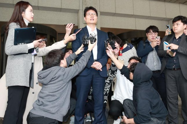 A Lotte Group executive speaks to reporters at the Supreme Court in Seoul on Oct. 17, 2019, after the top court delivered a final suspended jail sentence of 2 1/2 years to Lotte chief Shin Dong-bin. Photo by Yonhap