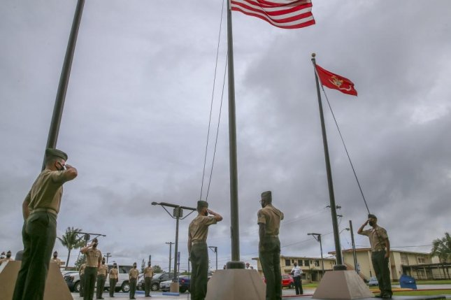 U.S. Marines and personnel assigned to Marine Corps Base Camp Blaz observe the first flag raising of the new command, marking the initial operation capability of the base in Dededo, Guam, on Thursday. Photo by Andrew King/U.S. Marine Corps