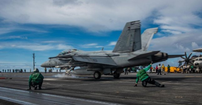 Boeing has been contracted to work with the U.S. Navy to develop enhanced missile technology for the F/A-18 Super Hornet, one of which is pictured landing on the USS Ronald Reagan. Photo by MC2 Samantha Jetzer/U.S. Navy
