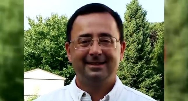 Dr. Larry Nassar was sued by 18 former patients Tuesday for sexual assault during medical exams, and named USA Gymnastics, Michigan State University and another gymnastics facility as negligent for doing nothing when complaints were lodged against him. Photo by WSYM-TV