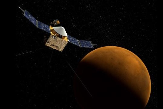 An artistic rendering of the MAVEN spacecraft, with Mars in the background. (NASA)