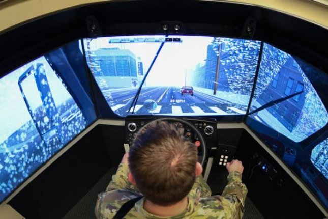 The new driver training simulator at Hill AFB, Utah, features three 55-inch video screens and is expected to save up to $100,000 per year in training and maintenance costs. Photo by Cynthia Griggs/U.S. Air Force