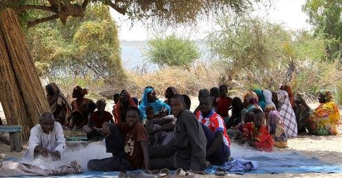 A group displaced from Nigeria by Boko Haram meets in Tagal, Chad. UN officials told the UN Security Council of the damage and devastation done in countries in the Lake Chad Basin by Boko Haram insurgents. Photo by Ivo Brandau/UN Office for the Coordination of Humanitarian Affairs.