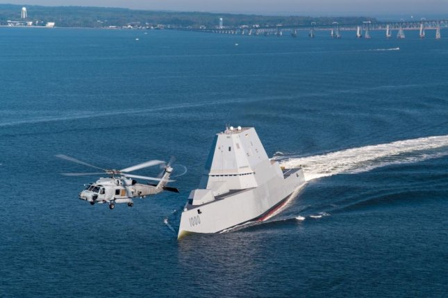 An SH-60R assigned to Air Test and Evaluation Squadron 21 flies near USS Zumwalt as the ship travels to its home port of San Diego, Calif. in 2016. Photo by Liz Wolter/U.S. Navy