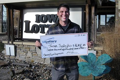 Jason Sydejko, meteorologist for KCCI-TV in Des Moines, Iowa, said he delivered the weather report on TV for two days with a nearly $17,000 winning lottery ticket in his pocket. Photo courtesy of the Iowa Lottery