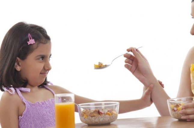 Atypical eating behaviors -- such as hypersensitivity to food textures or pocketing food without swallowing -- were found in 70 percent of kids with autism, the study found. Photo courtesy of HealthDay News