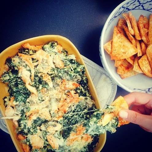 Teigen's spinach artichoke dip with cholula buffalo chicken. Photo by Chrissy Teigen/Instagram