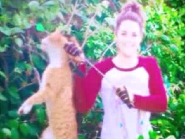 Texas veterinarian Kristen Lindsey posted this now-deleted photo of her showing off killing a neighborhood cat on Facebook. Her license was suspended for one year. Photo courtesy Kristen Lindsey/Facebook
