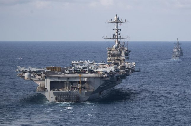 The Nimitz-class aircraft carrier USS Harry S. Truman, front, and the Ticonderoga-class guided-missile cruiser USS Normandy transit the Atlantic Ocean. The U.S. Navy announced this week 2nd Fleet Command has reached full operational capability. Photo by Scott Swofford/U.S. Navy