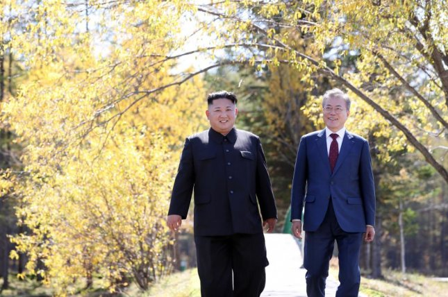 North Korean leader Kim Jong-un (L) and South Korean president Moon Jae-in talk as they visit at the Samjiyon guesthouse in North Korea, on September 20. Six out of 10 people in South Korea surveyed said they would support a trip by Kim to Seoul. Photo by Pyongyang Press Corps/EPA-EFE