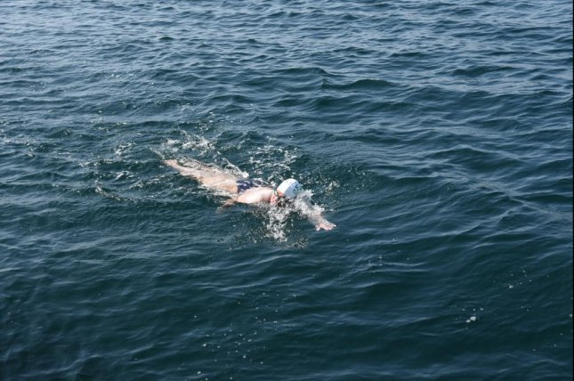 Elizabeth Fry became the Guinness World Record holder for the oldest person to complete the Oceans Seven swimming challenge at the age of 60 years, 301 days. Photo courtesy of Guinness World Records