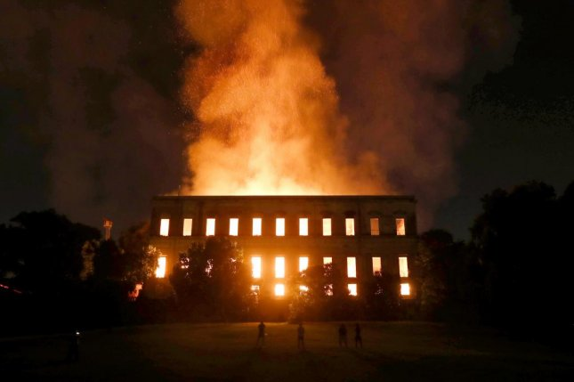 A fire burns inside the National Museum of Brazil in Rio de Janeiro, Brazil, on Sunday. The museum houses some 20 million pieces that date back to the Brazilian imperial era. Authorities have said the cause of the fire is still unknown. Photo by Marcelo Sayao/EPA-EFE