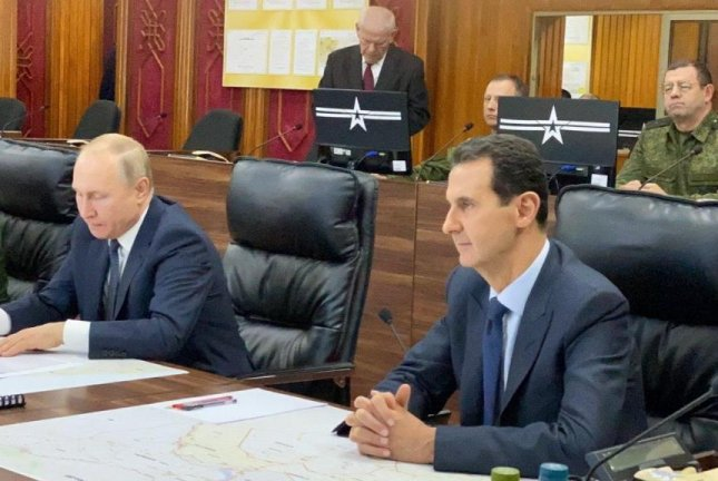 Syrian President Bashar al-Assad (R) and Russian President Vladimir Putin meet Tuesday at the headquarters of the Russian forces in Damascus, Syria. Photo courtesy of Syrian Presidency/EPA