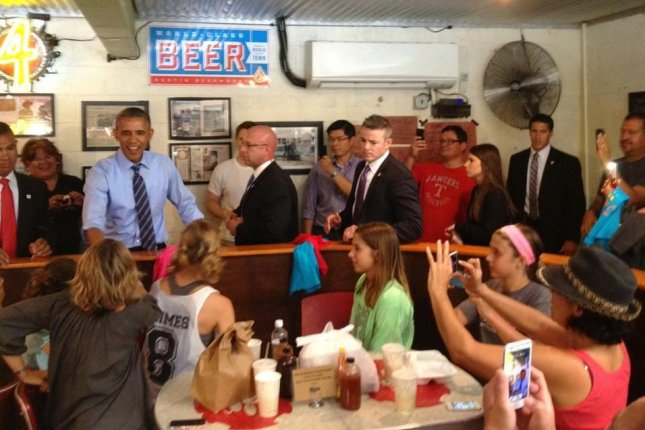 President Obama chats with diners at Franklin's Barbecue in Austin, Texas on July 10, 2014. (Twitter/KLBJ FM)