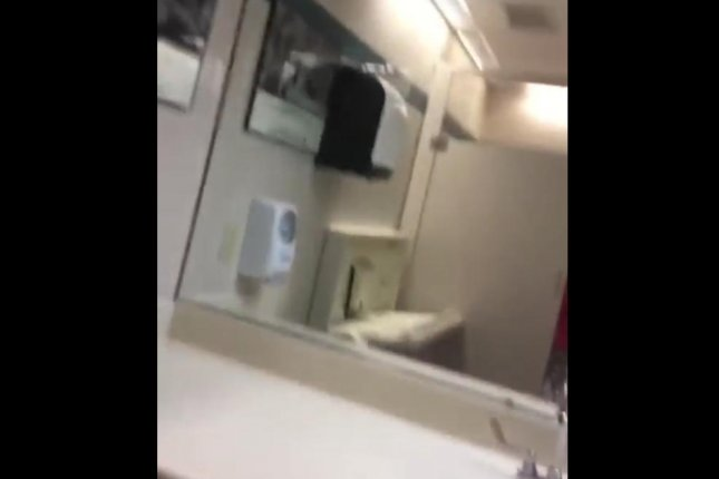 Watch Changing Table Traps Woman In School Bathroom Stall UPIcom - School bathroom stalls