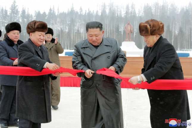 North Korean leader Kim Jong Un (C) cuts a ribbon to open a Township of Samjiyon County in a photo from KCNA published Monday. Photo by KCNA/EPA-EFE