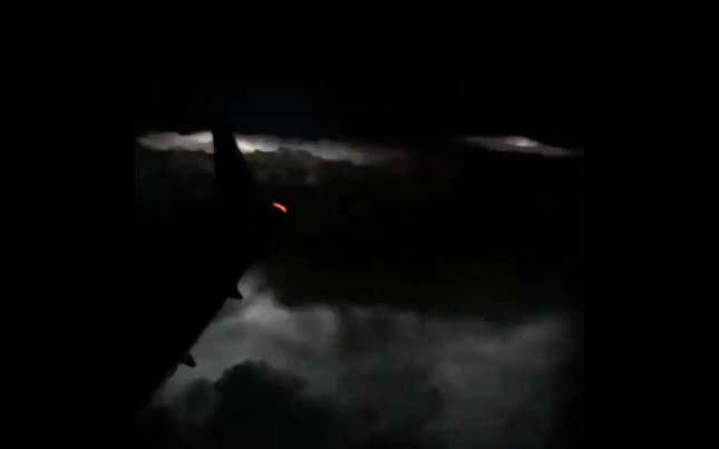 Facebook user Dan Holzmann shared video from an airplane as it flew over a tornado in the New Orleans area on Tuesday. The plane landed safely, but storms in the southern United States continued to cause extreme weather conditions. Screen capture/Dan Holzmann/Facebook