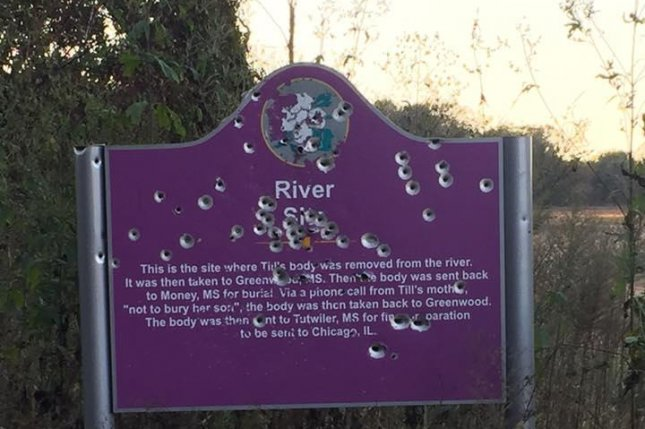 A sign marking the spot where 14-year-old Emmett Till's body was found in the Tallahatchie River in 1955 was found riddled with bullet holes last week. A picture posted on Facebook, above, went viral and help the Emmett Till Interpretive Center raise more than enough money to replace the sign. Photo by Kevin Wilson Jr.