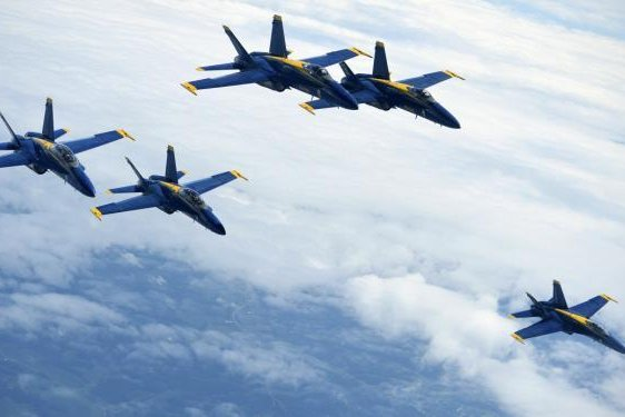 Five of the U.S. Navy F/A-18 Hornet Blue Angels from Pensacola Naval Air Station, Florida, fly beside a 434th Air Refueling Wing KC-135R Stratotanker over the Midwest on July 25, 2018. Photo by Staff Sgt. Katrina Heikkinen
