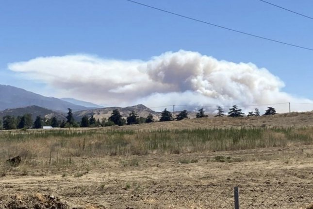 Smoke is visible on the east side of the Apple Fire where firefighters are carrying out controlled burn operations to prevent further spread of the blaze. Photo courtesy of the San Bernardino National Forest