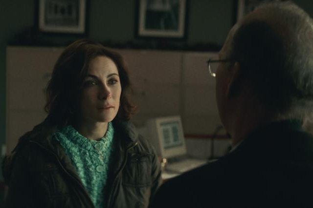 Karen Donato (Laura Benanti) tells Ken Feinberg (Michael Keaton) why she doesn't want any compensation for her husband's death in the Sept. 11 terrorist attack on New York. Photo courtesy of Netflix