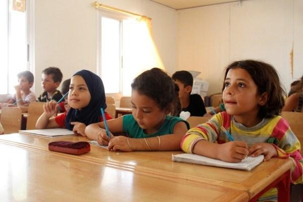 A fourth-grade class studies in a classroom in the Al Karnak camp in the city of Tartous, Syria, on March 6. Photo courtesy of UNICEF