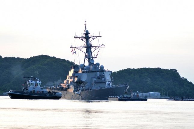 The U.S. Navy's Arleigh Burke-class guided-missile destroyer USS Fitzgerald returns to Fleet Activities Yokosuka following a collision with a merchant vessel while operating southwest of Yokosuka, Japan, on June 17, 2017. Photo by Mass Communication Specialist 1st Class Peter Burghart/U.S. Navy