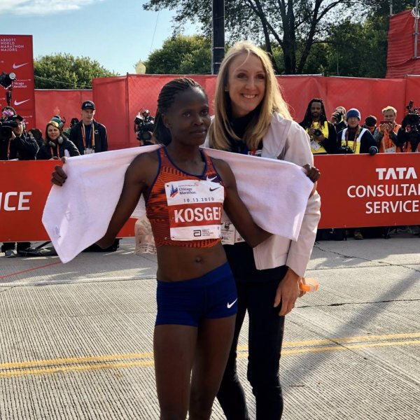 Kenya's Brigid Kosegi poses with Britain's Paula Radcliffe after beating her world record in the women's marathon during the Chicago Marathon on Sunday. Photo courtesy Chicago Marathon