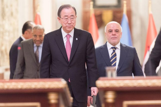 U.N. Secretary-General Ban Ki-moon, center, and Iraqi Prime Minister Haider Al-Abadi, right, review economic threats in the era of terrorism and lower crude oil prices. U.N. Photo by Mark Garten