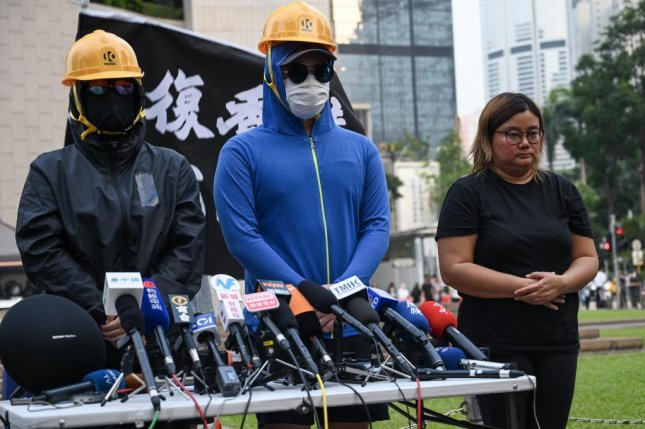 Members of the Citizens Press Conference activist group said Tuesday's planned rallies during China's National Day celebrations would be a milestone in the protest movement. Photo by Thomas Maresca/UPI