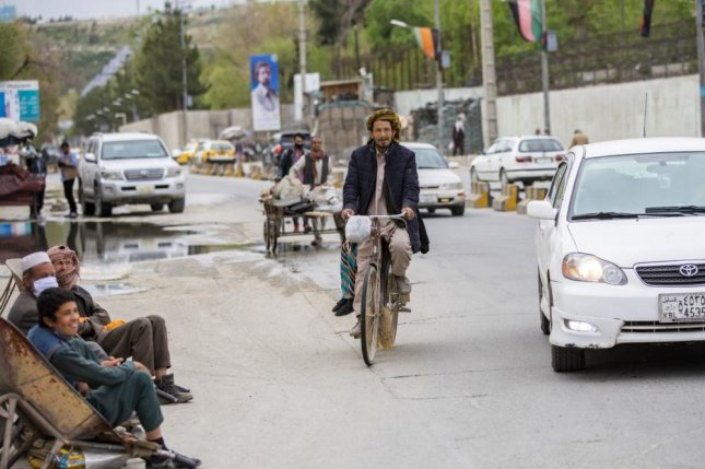 An Afghan civilian rides his bike in the city streets of Kabul, Afghanistan, in this April 2020 photo. Photo by Jeffery J. Harris/U.S. Army