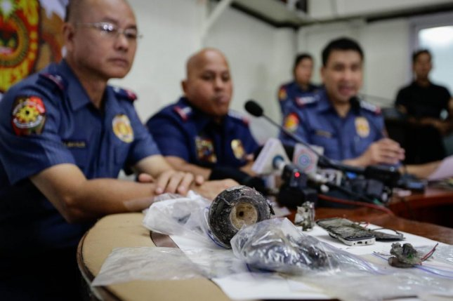 Police in the Philippines detained two men on Wednesday in connection with an IED found outside the U.S. embassy Monday morning, parts of which were shown to reporters at a press conference on Nov. 28. The attempted bombing was one of two this week, with the other injuring several people in Philippine President Rodrigo Duterte's advance team on Tuesday. Photo by Mark R. Cristino/European Pressphoto Agency