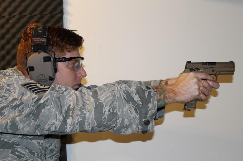 Tech. Sgt. Brady Craddock fires an M18 handgun at the Air Force Gunsmith Shop at Joint Base San Antonio-Lackland in San Antonio. Photo by Vicki Stein/U.S. Air Force