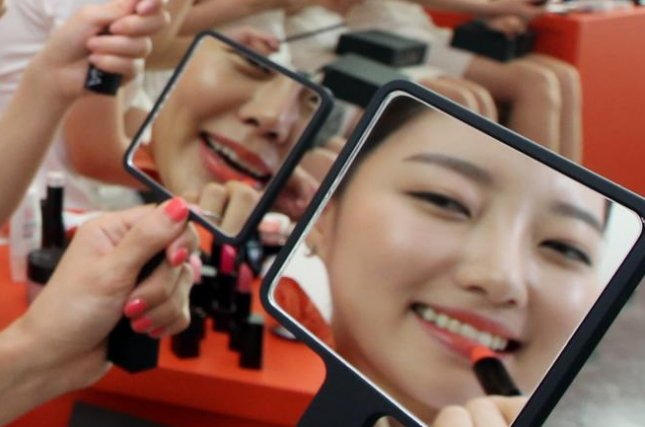 South Korea's growing beauty industry should be the focus of new economic growth, President Moon Jae-in said Thursday, according to the presidential Blue House. File Photo by Yonhap/EPA