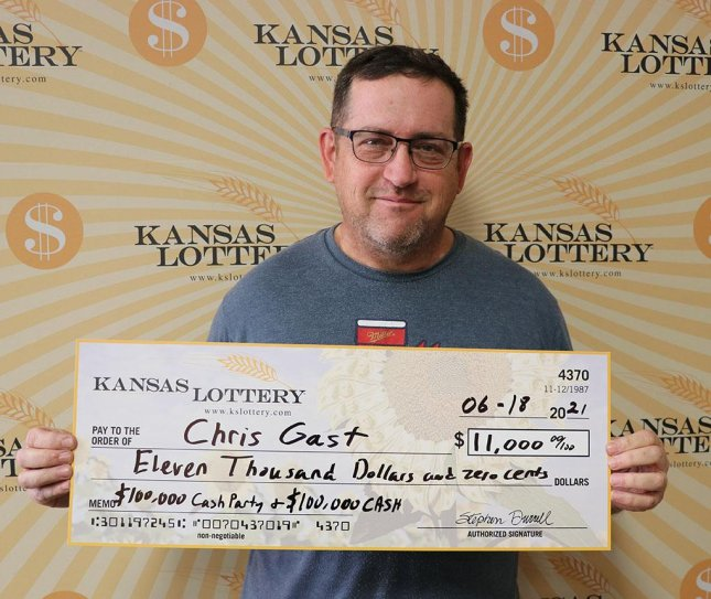 Chris Gast of Wamego, Kan., won a $1,000 prize from a scratch-off lottery ticket while waiting for his day off from work to collect a $10,000 prize from another ticket. Photo courtesy of the Kansas Lottery
