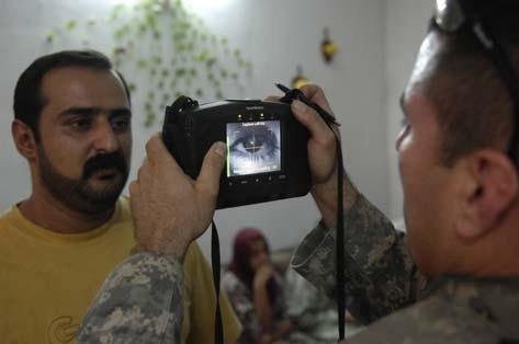 A U.S. serviceman uses a handheld iris scanner in the Middle East. (Photo: DOD Biometrics Consortium)
